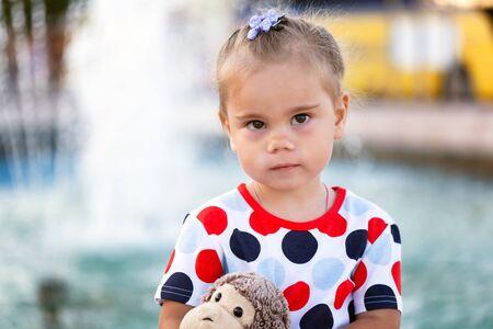 Portrait of upset little girl standing outdoor