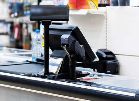 Cash desk with terminal in supermarket
