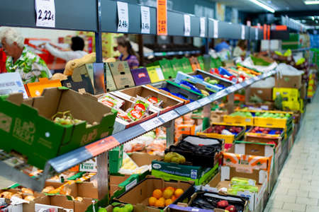 Fruits and vegetables on the shelves at a supermarket 新闻类图片