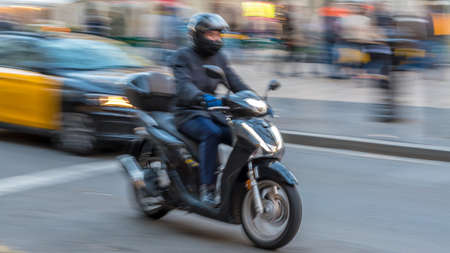 Panning of a motorcycle in Barcelona Spain
