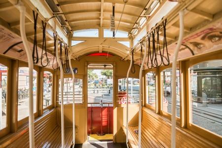 SAN FRANCISCO, CALIFORNIA, USA - OCTOBER 12, 2018: Detail of the interior of one of the tram cars cable car of San Francisco, California, USA