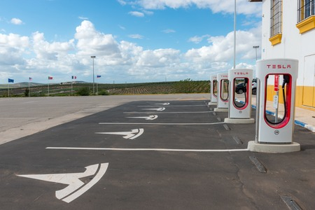 Details of a Tesla electric supercharger stand at a gas station in Spain