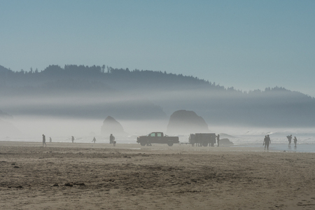 The ocean mist enters at sunset in Cannon Beach, Oregon, USA.