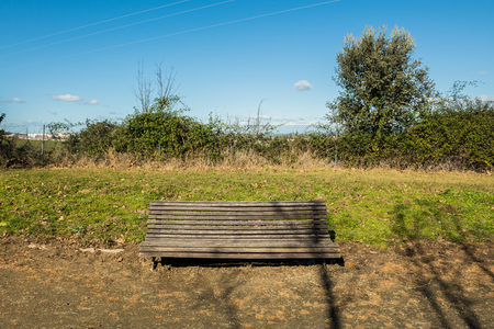 A bench a little dilapidated in a park in a suburb of Caceres, Extremadura, Spain.