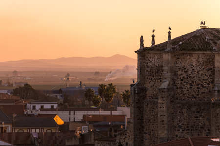 Sunset views of the church of Santa Cecilia and the town of Medellin Imagens