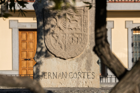 The coat of arms of Hernan Cortes in a monolith that indicates the place of his room in a square of Medellin