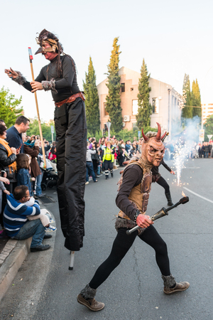 People masquerading as demons frightening people on the occasion of the feast of St. George. Editorial