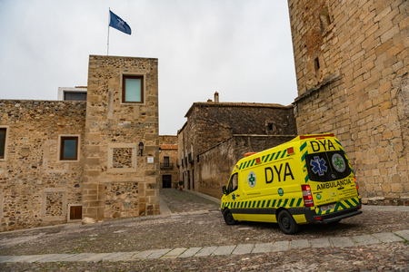 An ambulance stopped at the Plaza de San Mateo in the old town of Caceres, Extremadura, Spain. Editorial