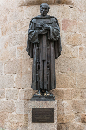 Statue of San Pedro de Alcantara located at the gates of the cathedral of Santa Maria in the city of Caceres Editorial