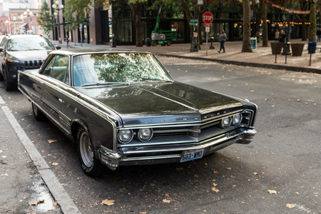 Chrysler classic car in a street next to Occidental Square in Seattle, Washington, USA. 스톡 콘텐츠 - 121150976