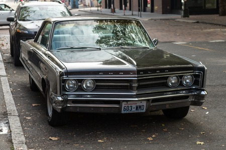 Chrysler classic car in a street next to Occidental Square in Seattle, Washington, USA. 스톡 콘텐츠 - 121150981