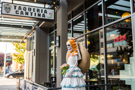 A sculpture of a skeleton bride at the entrance of the Taqueria Cantina in Seattle