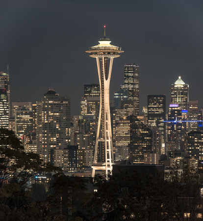 Night view of the Seattle skyline with the Space Needle and other iconic buildings in the background.
