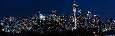 Panoramic night view of the Seattle skyline with the Space Needle and other iconic buildings in the background. Editorial
