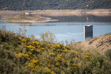 Tower of Floripes submerged in the water of the Tagus in the reservoir of Jose Maria Oriol near Garrovillas de Alconetar