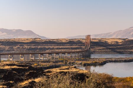 Sunset view of The Dalles bridge over the Columbia River that separates Washington and Oregon states