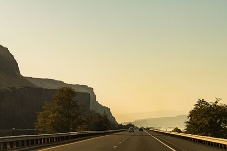 The US-30 highway passing by the Columbia River near The Dalles Stock Photo