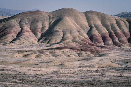 Detail of one of the wavy and colorful hills in Painted Hills at sunset, Oregon, USA.