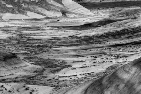 Black and white photograph of the arid landscape of Painted Hills, Oregon, USA. Фото со стока