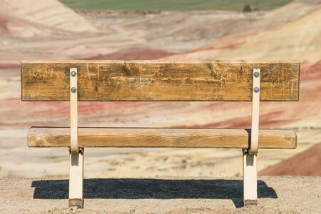 Detail of a bench facing the colorful landscape in Painted Hills Overlook, Oregon, USA.