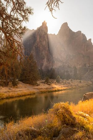 The evening sun illuminates the Crooked River as it passes through the peaks of the rock walls of Smith Rock State Park