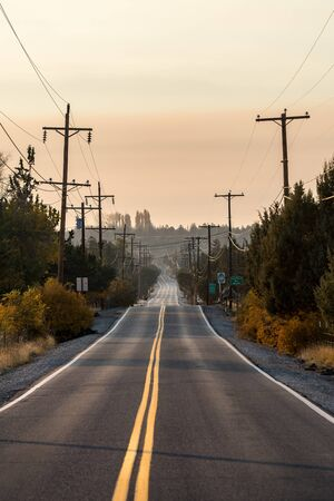 Sunset view of Lambert Road next to Smith Rock State Park in the background Stock Photo