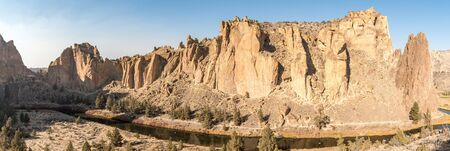 Panoramic sunset view of the Smith Rock stone walls and the Crooked River Stock Photo