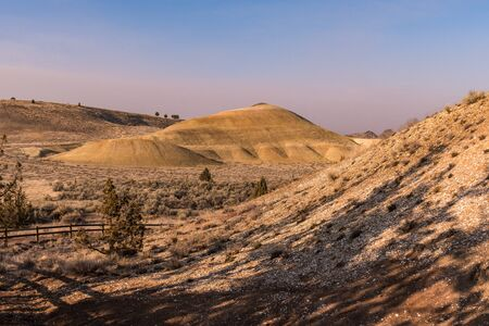 Yellow hill behind the Leaf Hill in Painted Hills, Oregon, USA.