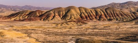 Panoramic view of one of the wavy and colorful hills of Painted Hills at sunset, Oregon, USA. Stock Photo