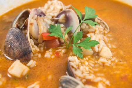 Detail of a dish of Spanish rice with clams