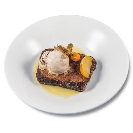 A spanish style French toast with vanilla ice cream on a white background Banque d'images