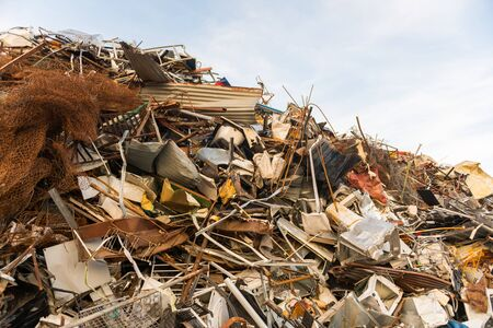 A huge mountain of metal pieces of different origin accumulated in a scrap yard