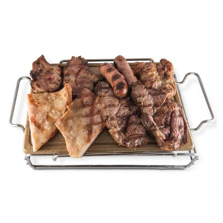 Barbecue of varied meats with chorizo criollo, chicken, pork secret, veal chops served on a hot stone.