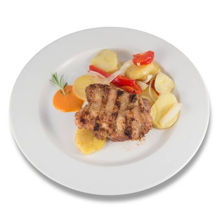 Plate of roasted chicken steak with baked potatoes.