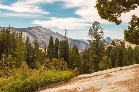 Views from Olmsted Point of the natural environment of Yosemite National Park with the Half Dome in the background Stock Photo