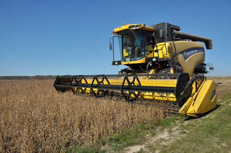 """Chortkiv - Ternopil - Ukraine - October 18, 2017. Beginning of soybean harvest using a powerful combine harvester in the agrarian company """"Nichlava"""" Editorial"""