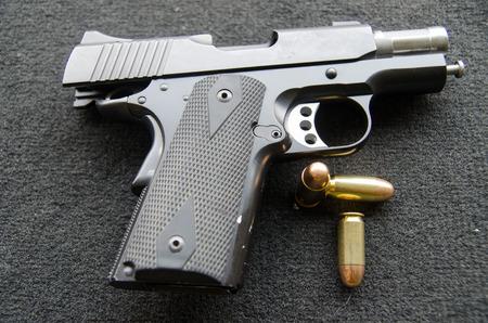 automatic short gun  and  bullets