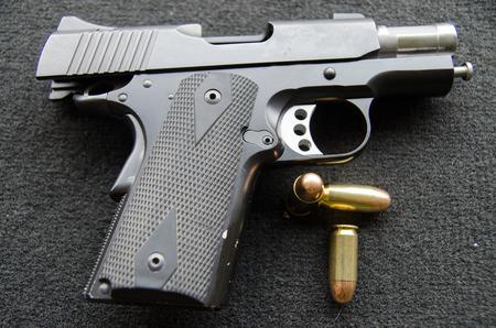short gun  and tree bullets