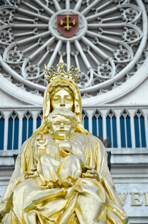mother mary: Golden baby Jesus and mother Mary  Stock Photo