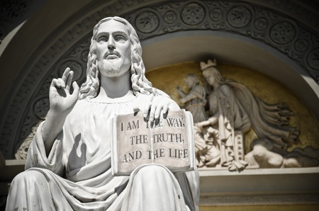 Jesus statue with the quote book photo