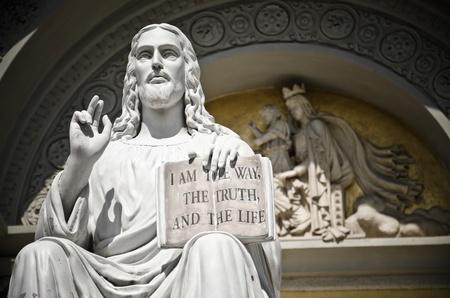 PosÄ…g Jezusa z książkÄ… cytatem Zdjęcie Seryjne