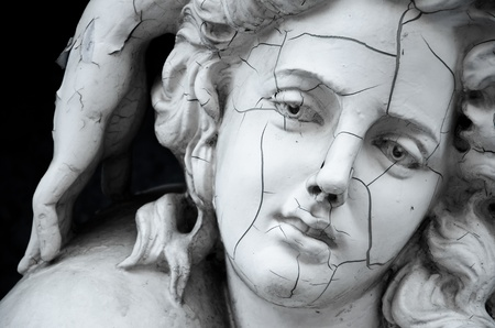 greek mythology: Cracked face of female Greek sculpture