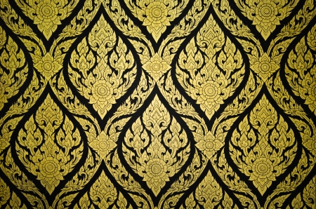 Thai floral pattern textured on a wall photo