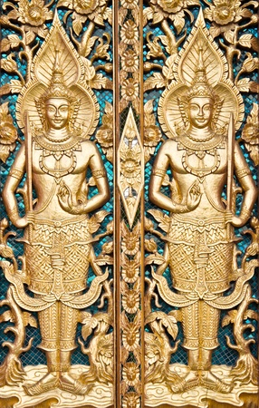 Thai textured gate at Wat Sirisaotong, Thailand photo