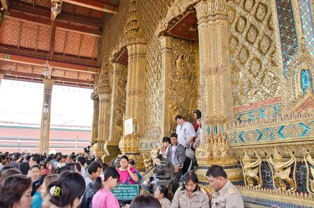 stupa one: Tourists flock to worship and pray the Emerald Buddha statue enshrined at Wat Phra Kaew in January 1, 2012, Bangkok, Thailand