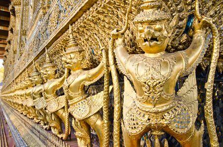 Golden Garuda statues at Wat Phra Kaew (Temple of the Emerald Buddha) in Thailand photo