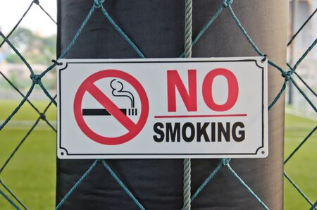 No smoking sign inside indoor football field photo