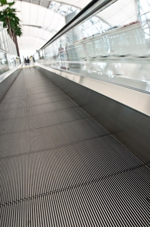The escalator moving in airport photo