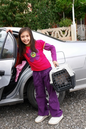 carrier: Little girl carry her cat for a car trip Stock Photo