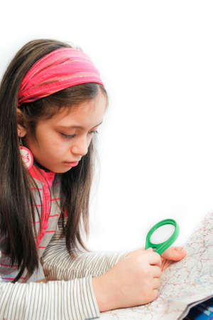 little girl search on map with a magnifier photo